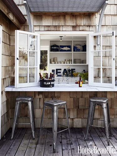 Pass through window over the sink: image via House Beautiful