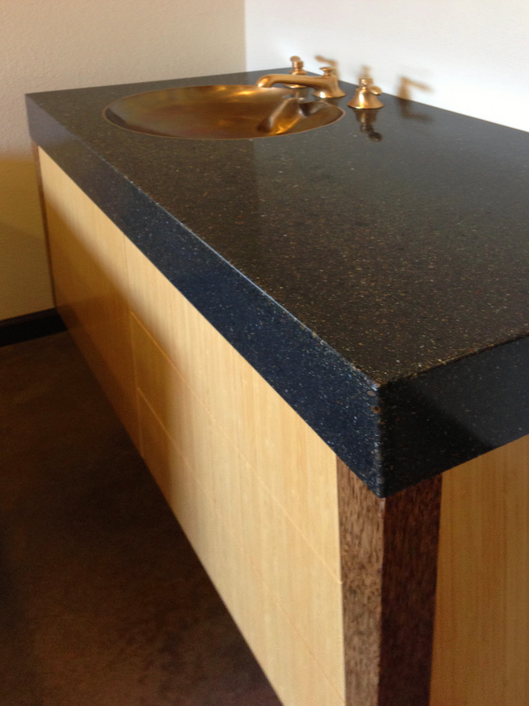counter tops here with inset brass sink by Bohemian Stoneworks, image by Irene Turner