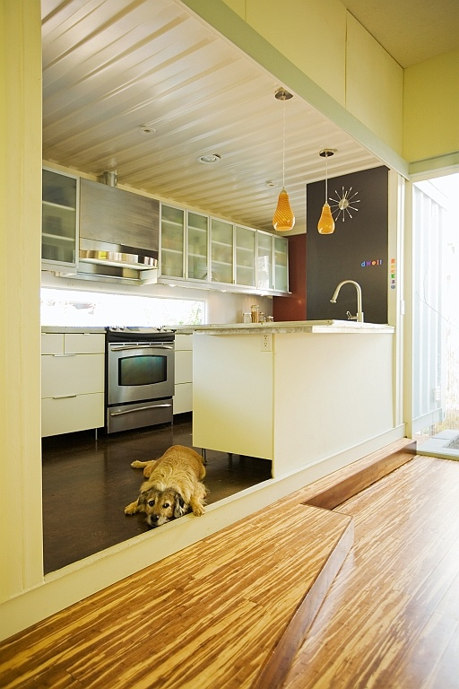 full and modern kitchen in this double wide container-image via modulux
