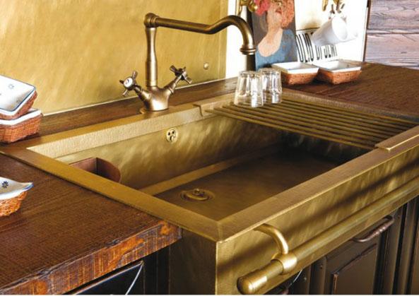 fabulous brass sink, towel rack and plumbing fixtures-image via the Right Bank